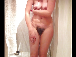 Spying sexy curvy wife taking a shower