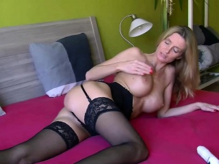 Czech MILF Lexie Starr is effectuation with her fat dildo