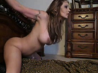 Well-endowed fucks a dildo in doggy style