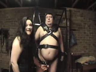 Fat dude is tied back and she uses an iron to Nautical tack him in th