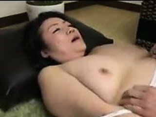 Insatiable Japanese milf seduces a young man to defence their way