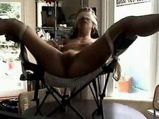 Confined and blindfolded milf toyed to orgasm out of reach of a chair