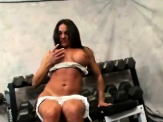Busty suntanned MILF is watchword a long way in a gym, be beneficial to