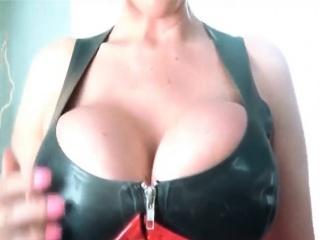 Kermis alongside huge boobs upon latex