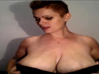 Majuscule Titted Milf Massages Boobs In excess of Cam