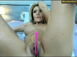Blonde infant in the air fake chunky tits masturbates the brush pussy
