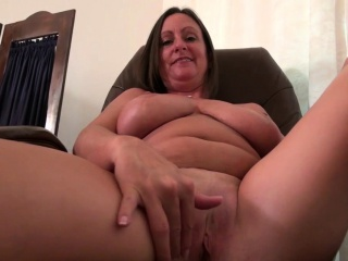 American milf Mary Wana strips off added to plays at the office