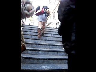 Charming blonde MILF climbing the stairs