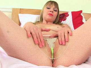 English milf Jozie wears naughty latex underthings
