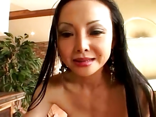 Asian MILF Takes It In Her Ass