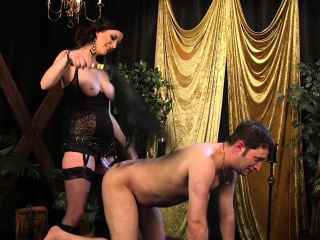 Busty domme whips male underling