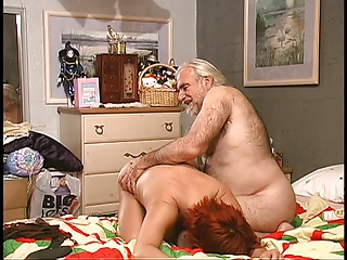 Hairy guy spanks busty redhead in bed