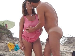 Gorgeous Milf on the beach with show one's age