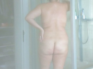 milf takes a shower