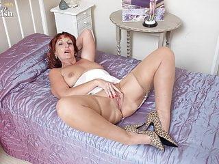 Libellous talking Milf strips masturbates anent girdle nylons heels