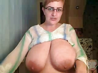 Natalie with huge tits shows her talents