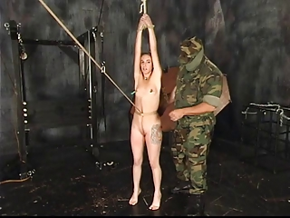 Guy in camouflage tortures chick in bondage