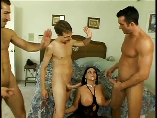 raven haired woman gets fucked by three guys