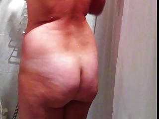 Hidden cam of sexy busty amateur MILF taking a shower part1