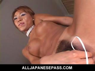MiLF uses a green egg vibrator to toy her succulant pussy