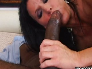 Astonishing gloomy haired MILF rides chiefly a black